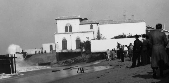The sea was a constant threat to Mae's seaside mansion.