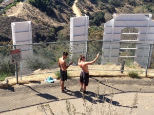 Two teens stripped bare-chested and scaled the fence. They took photos right before they went over.
