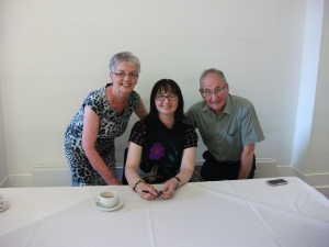 Michelle and her parents at a recent book signing.