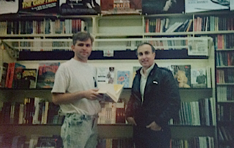 Michael (L) and writer Jim Parish in a bookstore in Los Angeles in the early 1990s