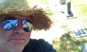 A selfie at Louise Glaum's grave.  Yes, I know I look like Jed Clampett. I am protecting my face from more sunburn.