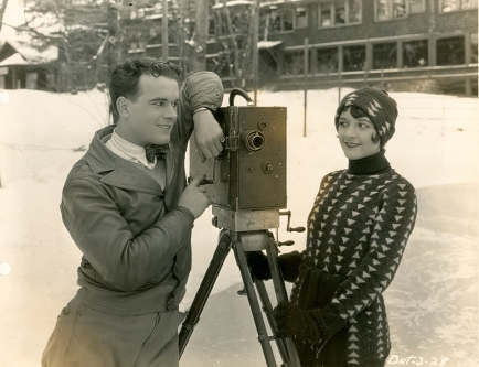 Sally and Nick Stuart during the filming of The News Parade (1928)